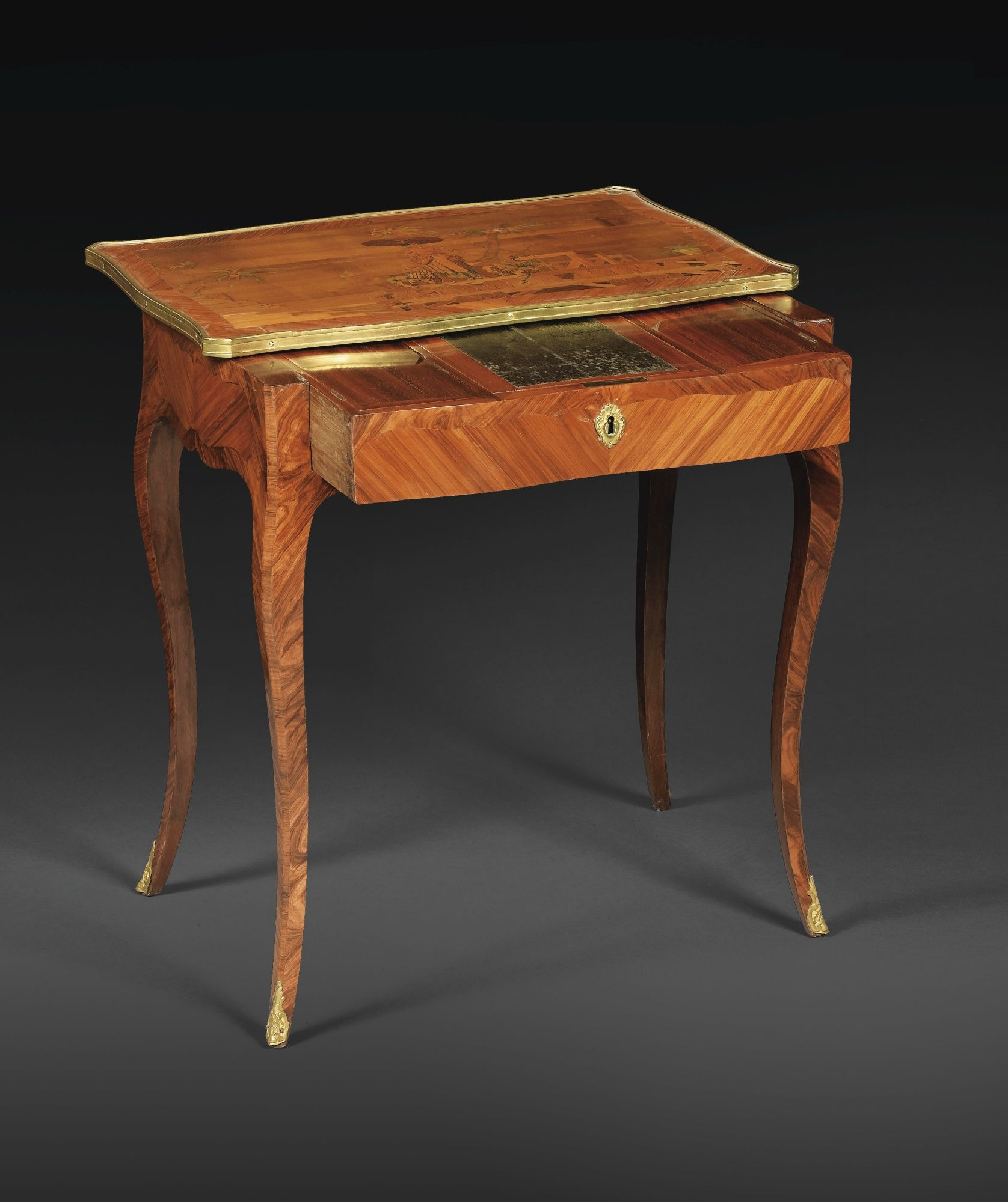 date unspecified A LOUIS XV MARQUETRY, TULIPWOOD AND KINGWOOD VENEERED WRITING TABLE Estimate  20,000 — 30,000  EUR 25,999 - 38,999USD. unsold