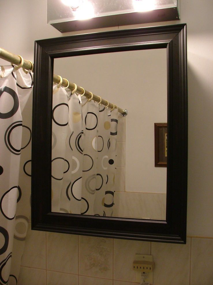 how to frame a medicine cabinet mirror old medicine cabinet gets a facelift for