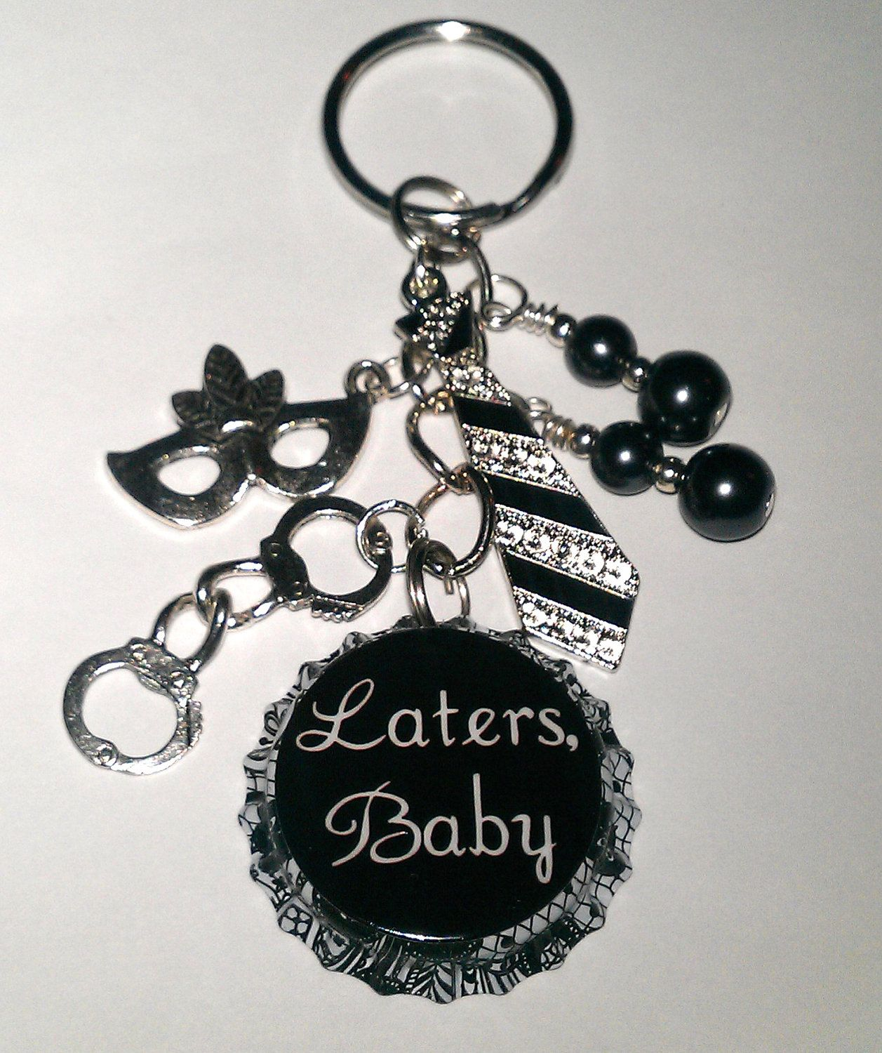 SALE Laters Baby Fifty Shades of Grey 50 Inspired Handcuffs Tie Mask Bottle Cap Keychain Key chain. $14.00, via Etsy.