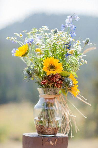 Real Weddings Real Wedding Photos In Colorado Weddingwire Com Flower Arrangements Wildflower Wedding Wedding Centerpieces