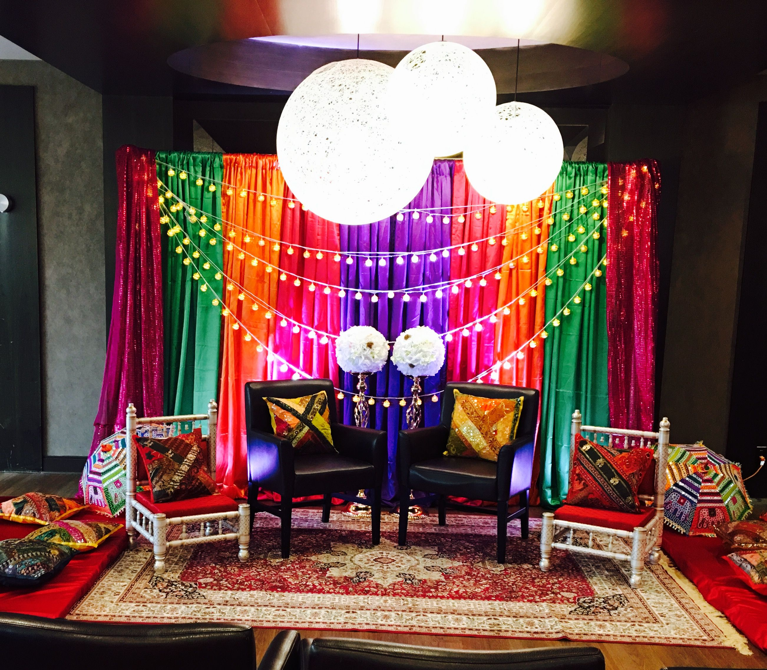 Colourful Mehndi backdrop with Moroccan lights by Marritain