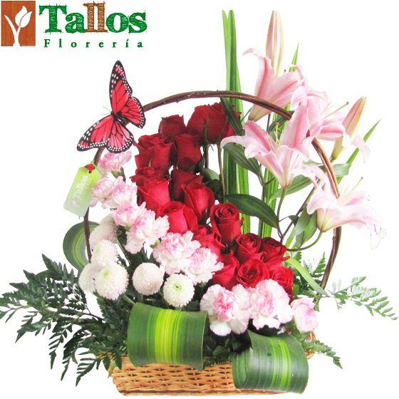 Arreglos florales - Canasta de rosas y liliums centros preciosos