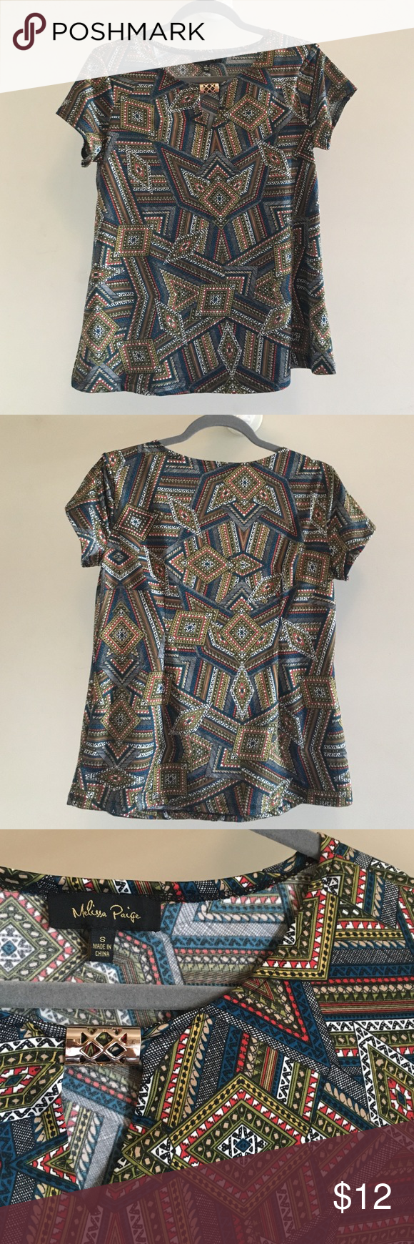 Cute patterned top. Multi color vintage looking top, great to dress up or down, cute gold peice at neck line. Very comfortable. Tops Blouses