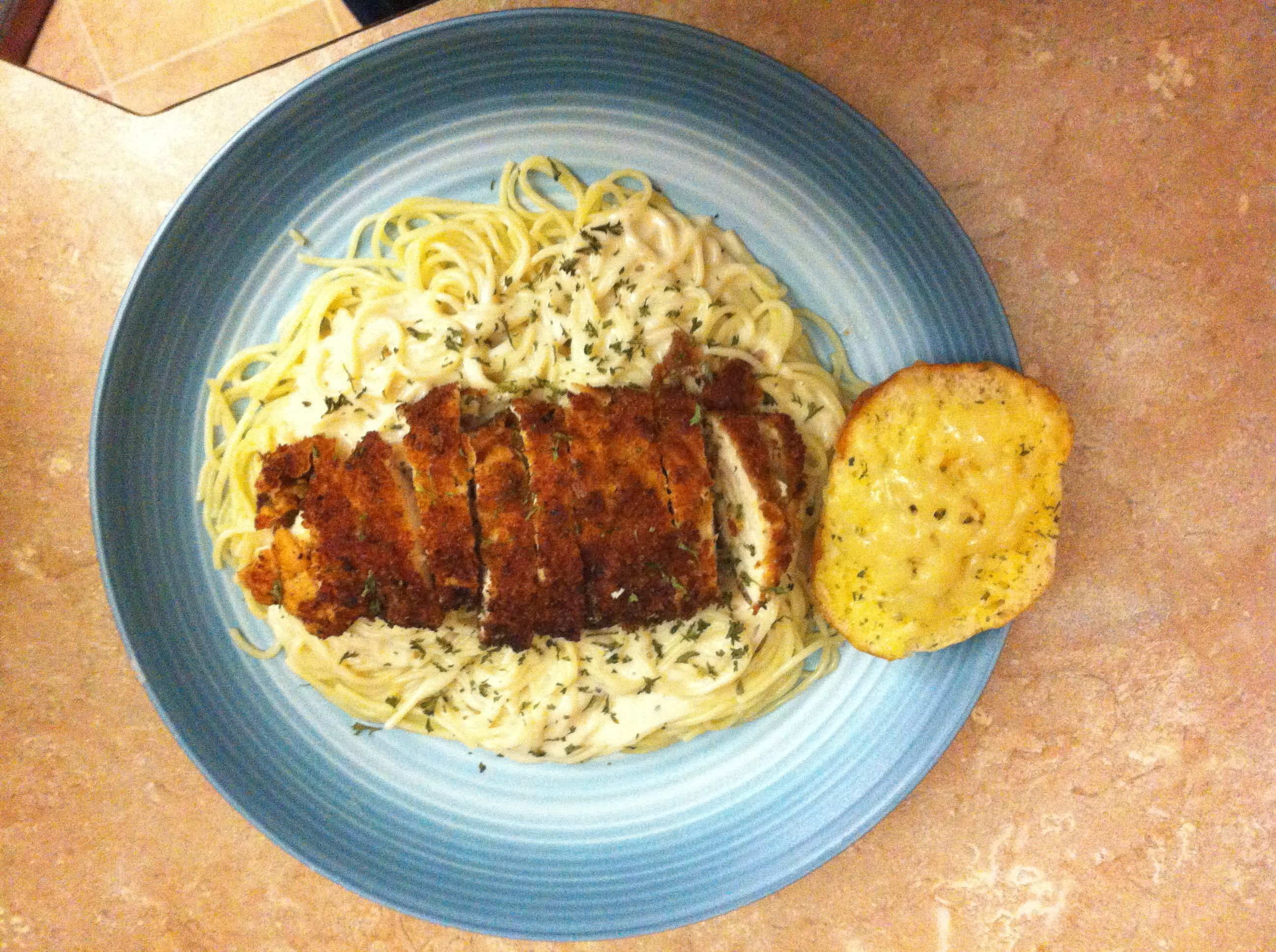 Parmesan Crusted Chicken Over Alfredo Sauce And Angel Hair Pasta Crusted Chicken Parmesan Crusted Chicken Food
