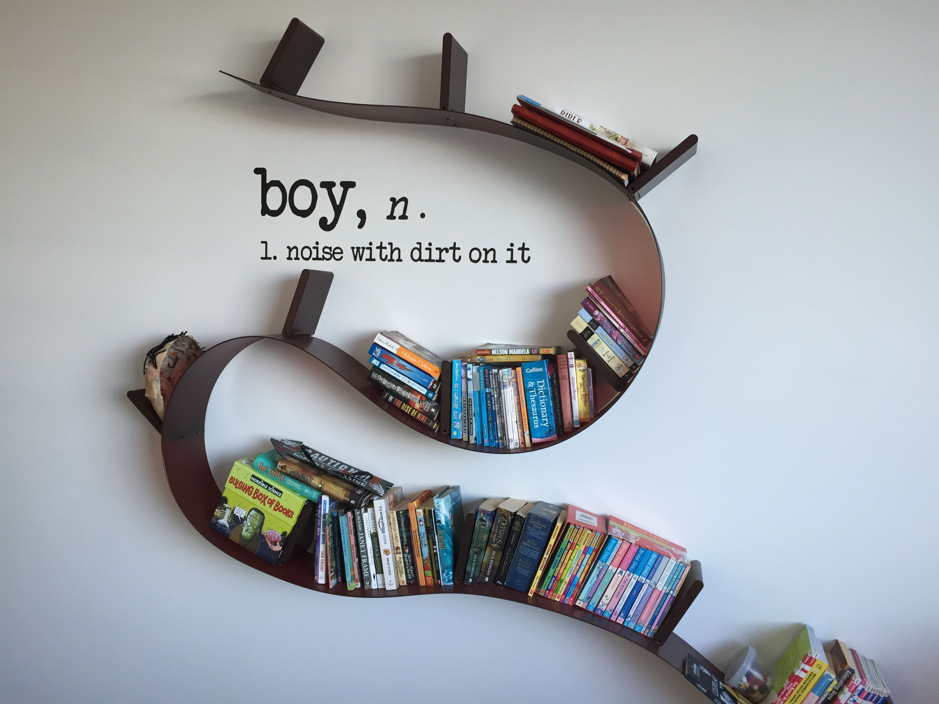 Fancy Kartell Bookworm bookshelf designed by Rob Arad with Grafix Wall Art boys noun sticker