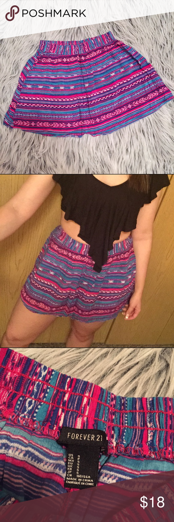 Aztec pattern skirt Pink and turquoise tribal pattern skirt. Flowy and fun and great with crop tops. Excellent condition! Forever 21 Skirts Circle & Skater