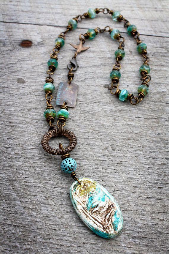 Features a handmade birds nest pendant by humble beads that is features a handmade birds nest pendant by humble beads that is suspended from a vintaj filigree aloadofball Choice Image