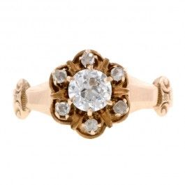 Doyle & Doyle Victorian Cluster Ring, Old Euro 0.33ct::centering an Old European cut diamond weighing app. 0.33ct., framed by six Rose cut diamonds measuring app. 1.5mm, fashioned in 10k. Circa 1900. Size 5.75