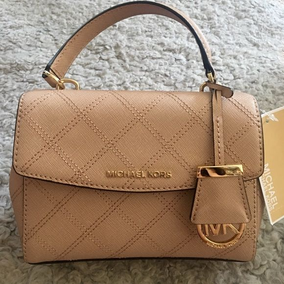 "Micheal Kors EXTRA-SMALL SAFFIANO CROSSBODY blush -100% Cow Leather  -Gold-Tone Hardware  -Top Handle: 4""  -Adjustable Strap: 21""-24""  -Exterior: One Slit Pocket  -Interior: One Zip Pocket, One Open Pocket  -Snap Fastening  -Interior Lining: 100% Polyester  -9.5"" X 6"" X 3""  -Color: Blush MICHAEL Michael Kors Bags Crossbody Bags"