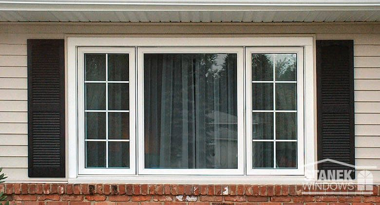 White 1 4 1 2 1 4 Three Lite Casement Windows With Colonial Grids On The Ends Learn More Casement Windows House Windows Windows Exterior
