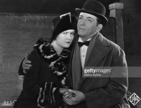 circa 1925: Edward Everett Horton (1886 - 1970) puts a consoling arm round Laura La Plante, a scene from the film, 'Robinson'