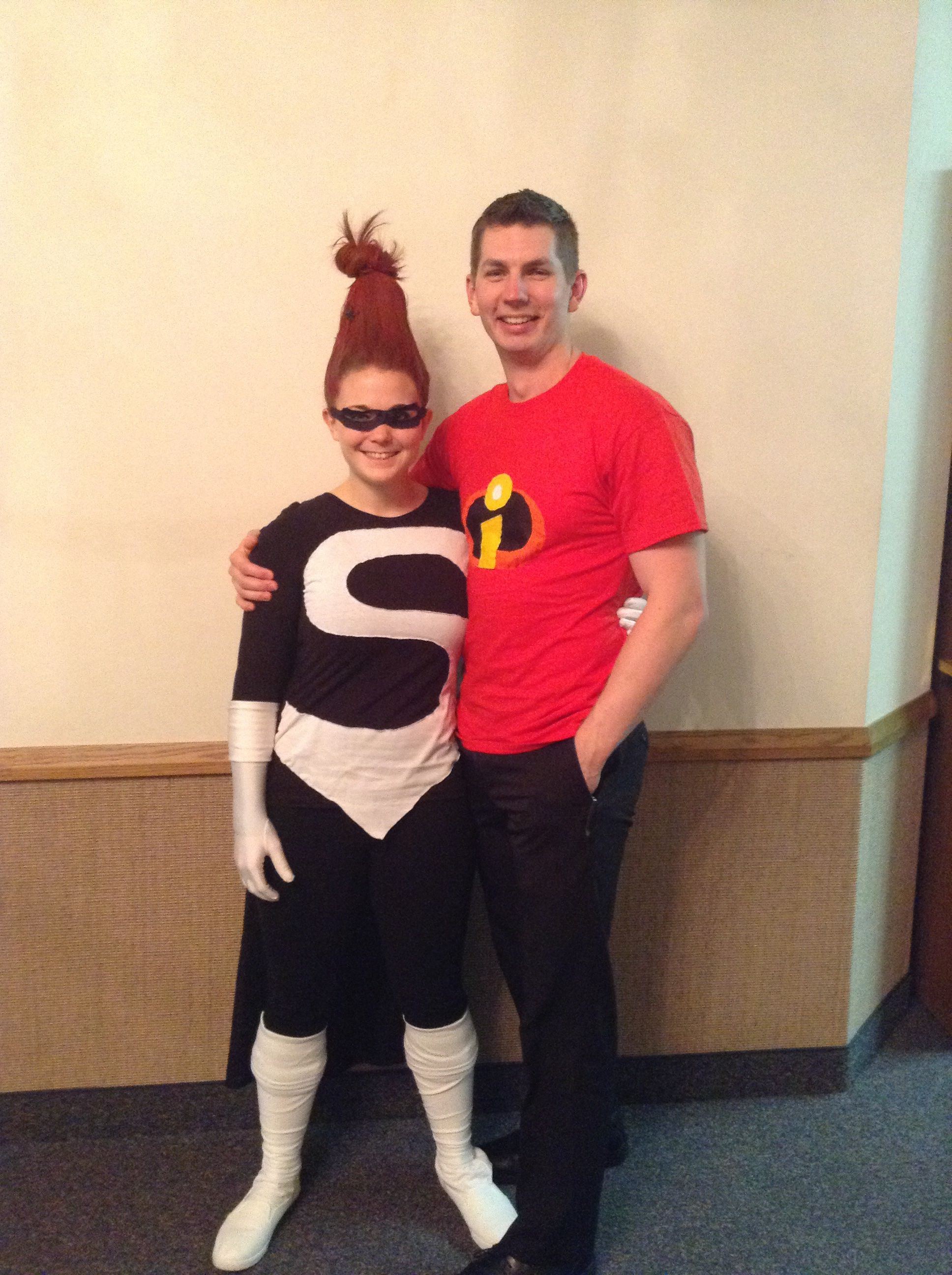 Syndrome and Mr. Incredible Halloween costume! Made these costumes by hand. Used a white t-shirt and cut out the S, then hand stitched it onto the black long sleeved shirt. Sewed a cape to the shoulders of the shirt, and then made and hand-stitched the incredibles emblem on my husband's shirt :) fun stuff! Put a water bottle on my head and wrapped my hair around it to get it to stand up straight. Then used lots of hair spray!