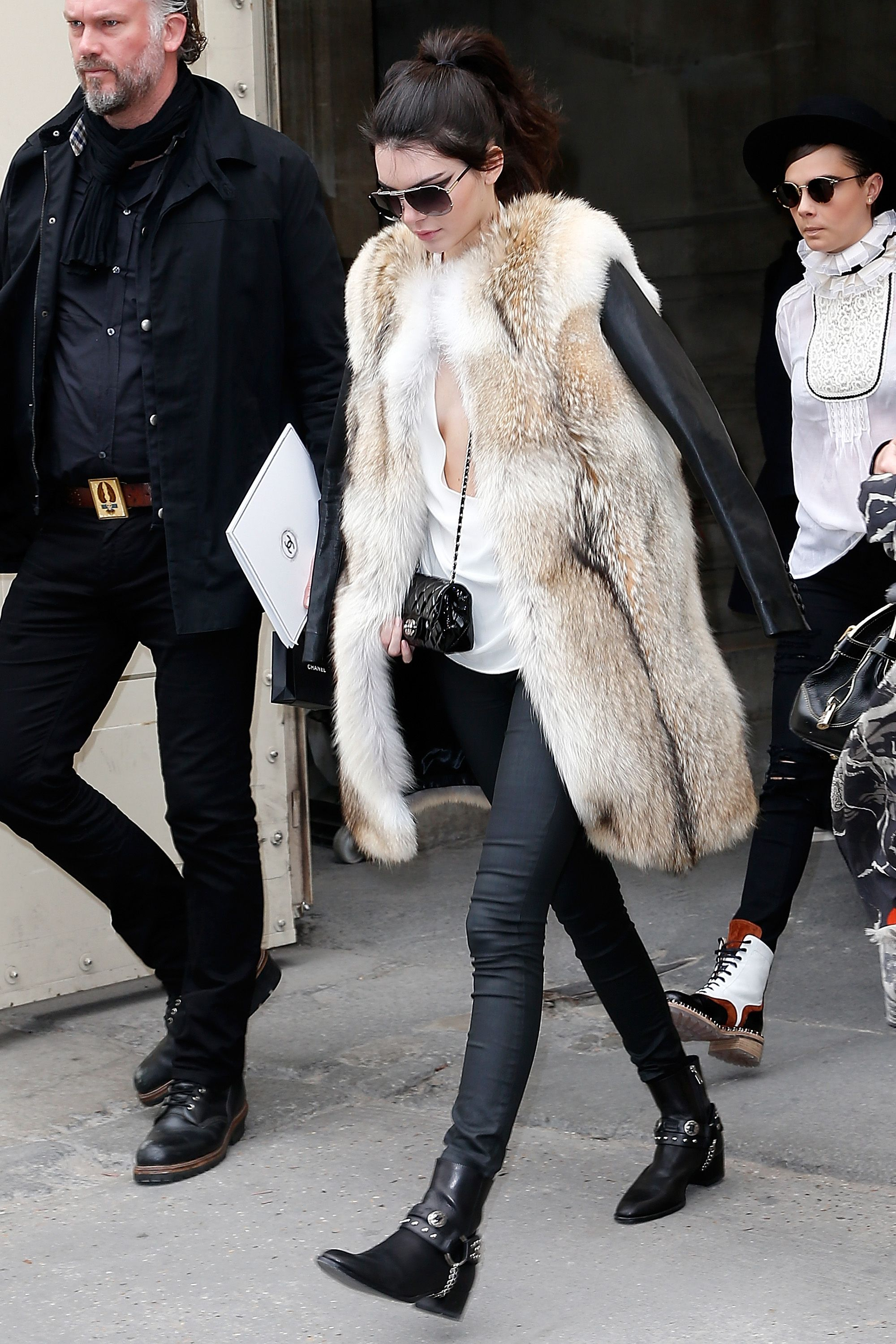 fdb432b13af Kendall completely owns this knee-length fur and leather coat. Paired with  short black boots and a pair of aviators