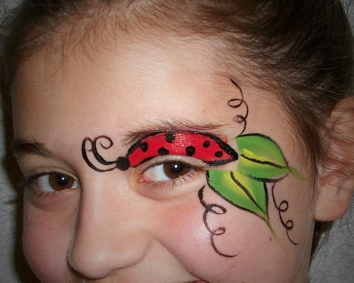 lady bug face- paint lots of face paint via Jolene Box