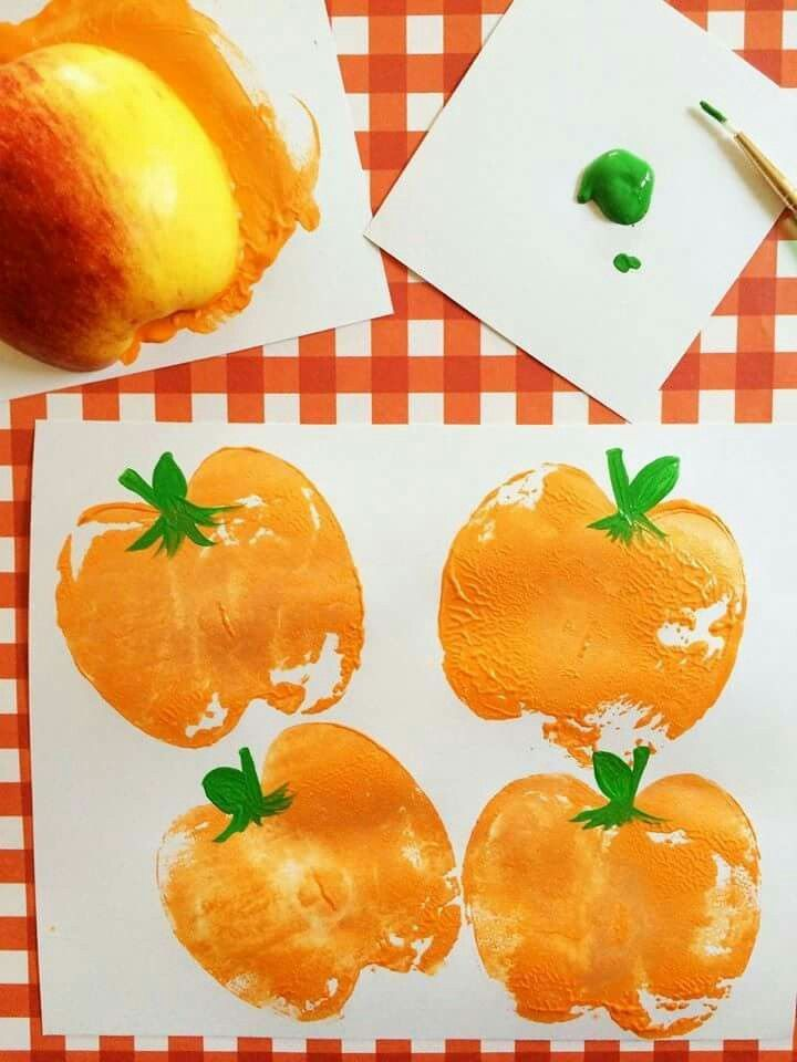 Cut an apple in half and dip in paint and press.