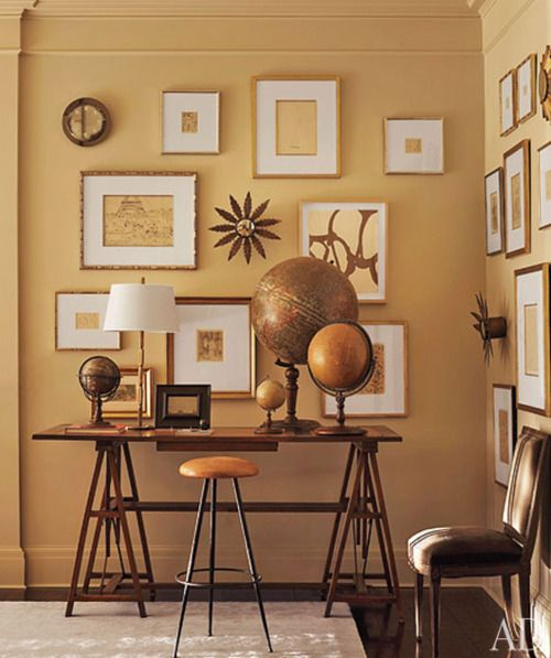 the colors in the tablescape compliment the wall decor