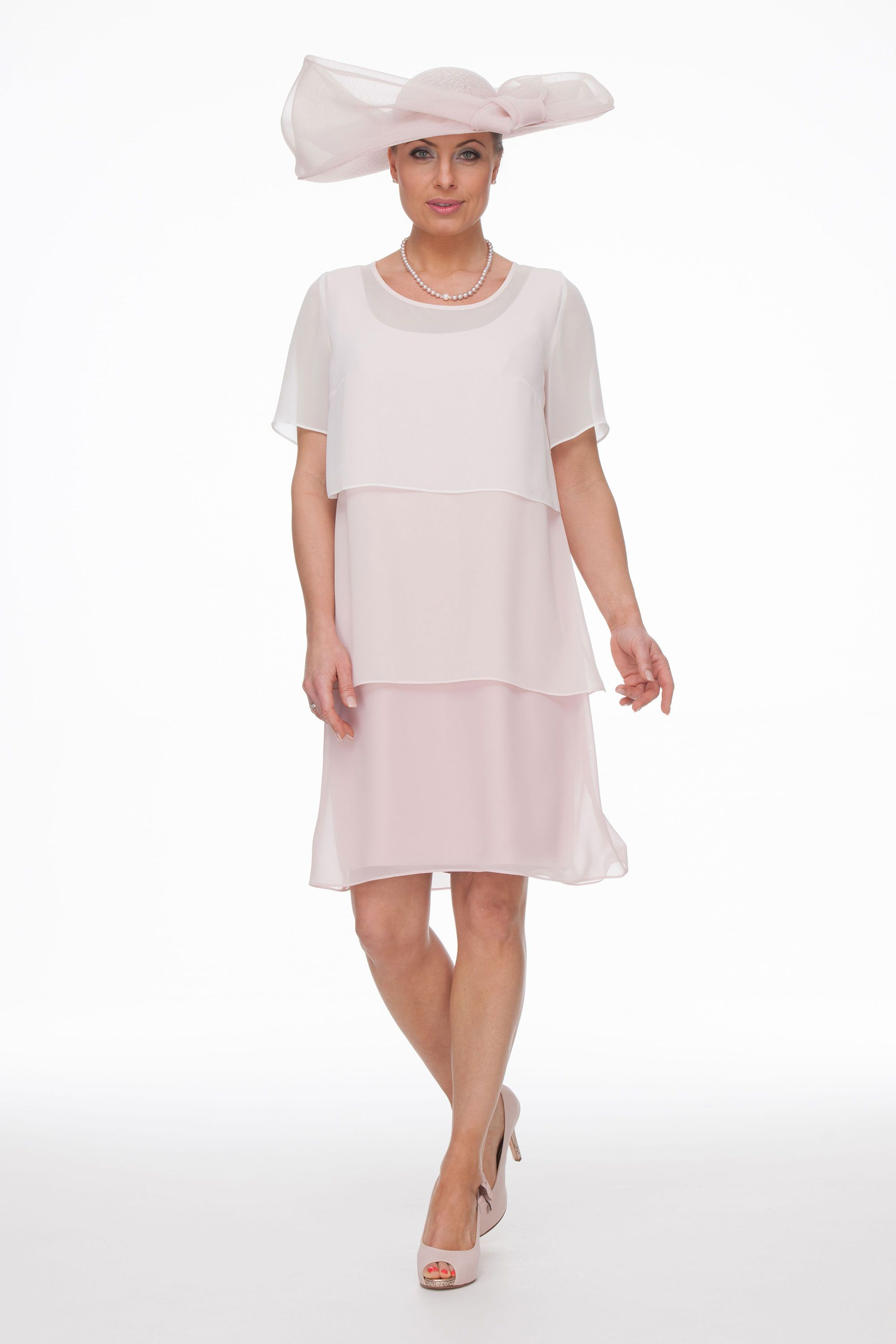 Pretty and floaty this layered chiffon dress is ideal for a relaxed summer  wedding. The short sleeve top comes off and the dress can be worn  sleeveless or ... fecf64bce0