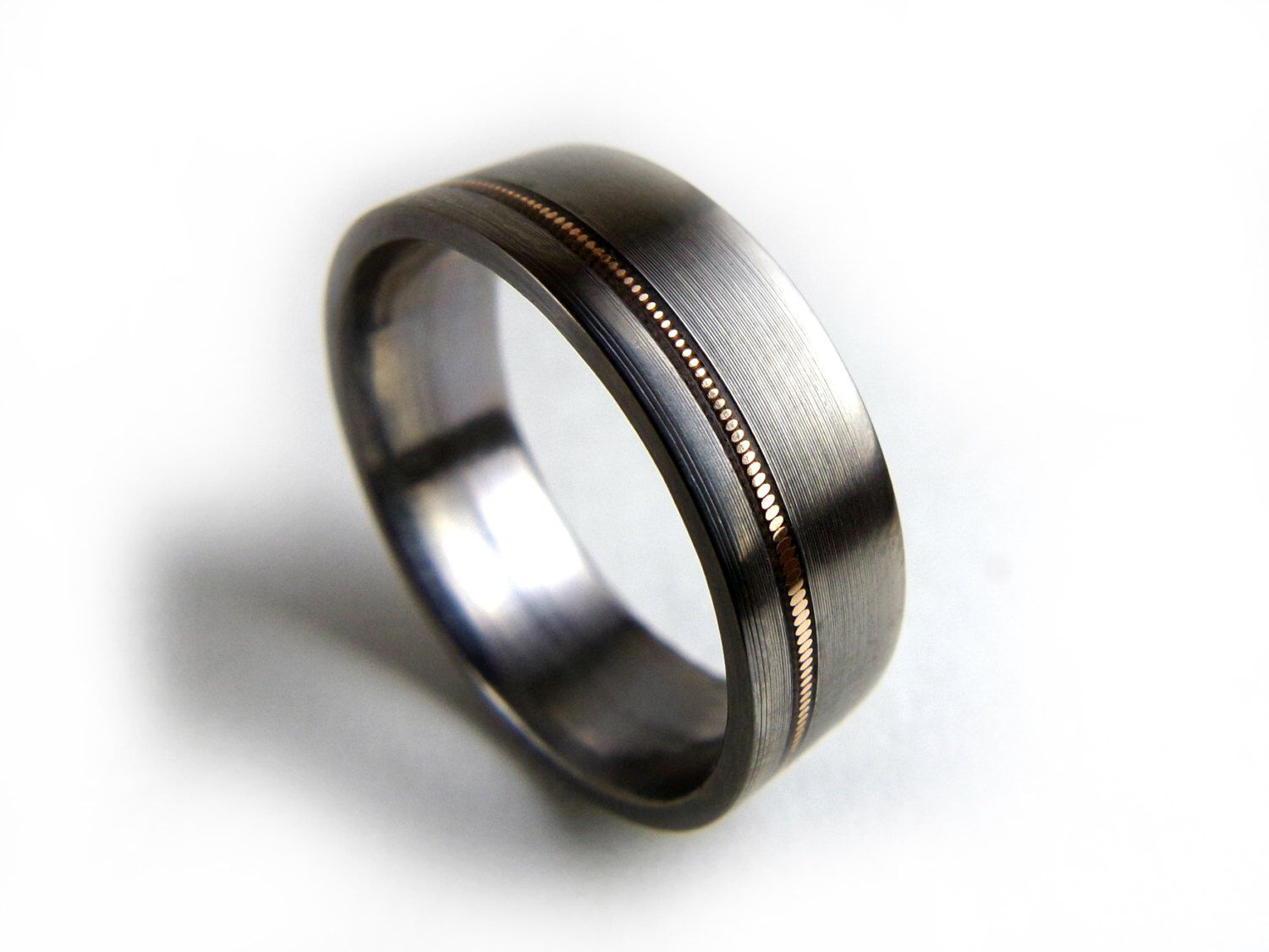 Guitar String Ring, Guitar String Jewelry, Guitar String Inlay, Ring for Men, Ring for Women, Titanium Band, Titanium Ring, Music Jewelry by GrandJunctionGuy on Etsy https://www.etsy.com/listing/229554582/guitar-string-ring-guitar-string-jewelry