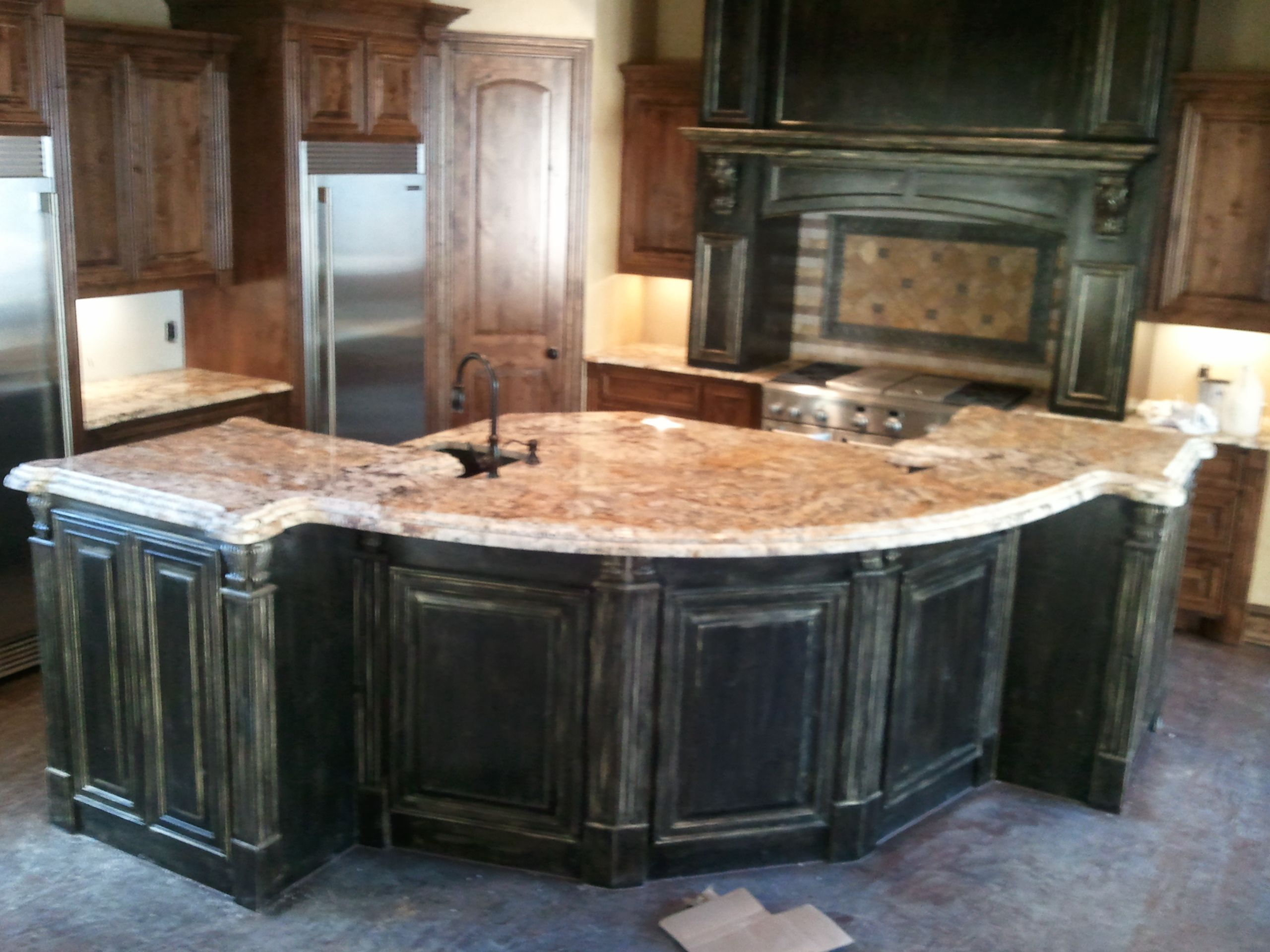 Betularie Granite with BlackGold distressed Cabinets