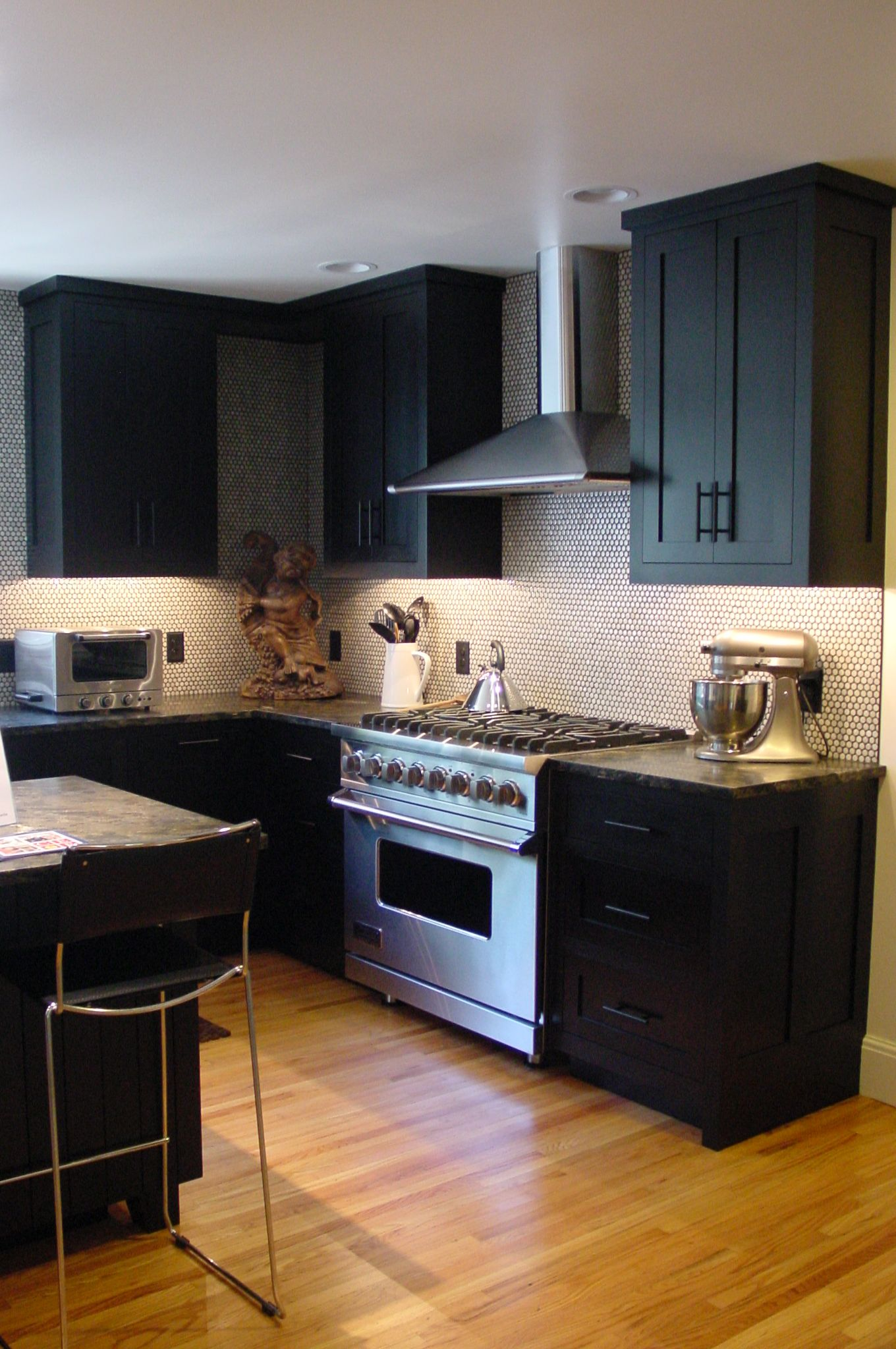This kitchen uses square inset doors and drawers concealed hinges