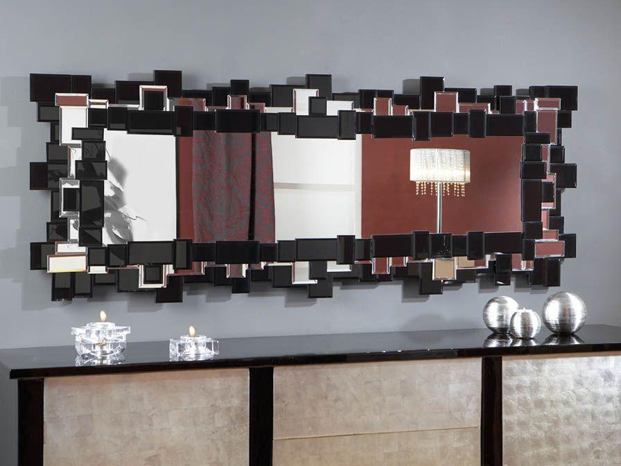 Espejo realizado con cristal negro y espejos biselados, colocados ...