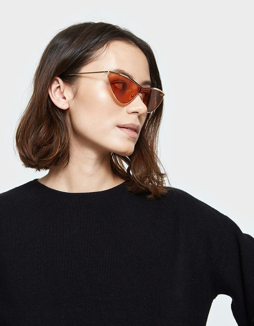 e0f3cdbe8b5 Needsupply Adam Selman x Le Specs The Fugitive in Bright Gold Tangerine  Tint Oval Sunglasses