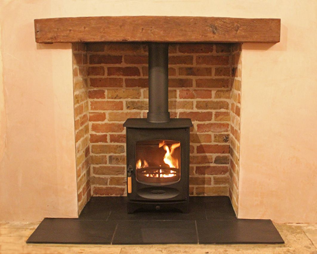 Reclaimed Brick Slip Chamber With Slate Tiled Hearth Reclaimed Clad Oak Beam And Charnwood C4