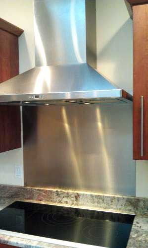 Give Your Range A Professional Look With A Stainless Steel Backsplash Stainless Steel Backsplash Stainless Backsplash Kitchen Arrangement