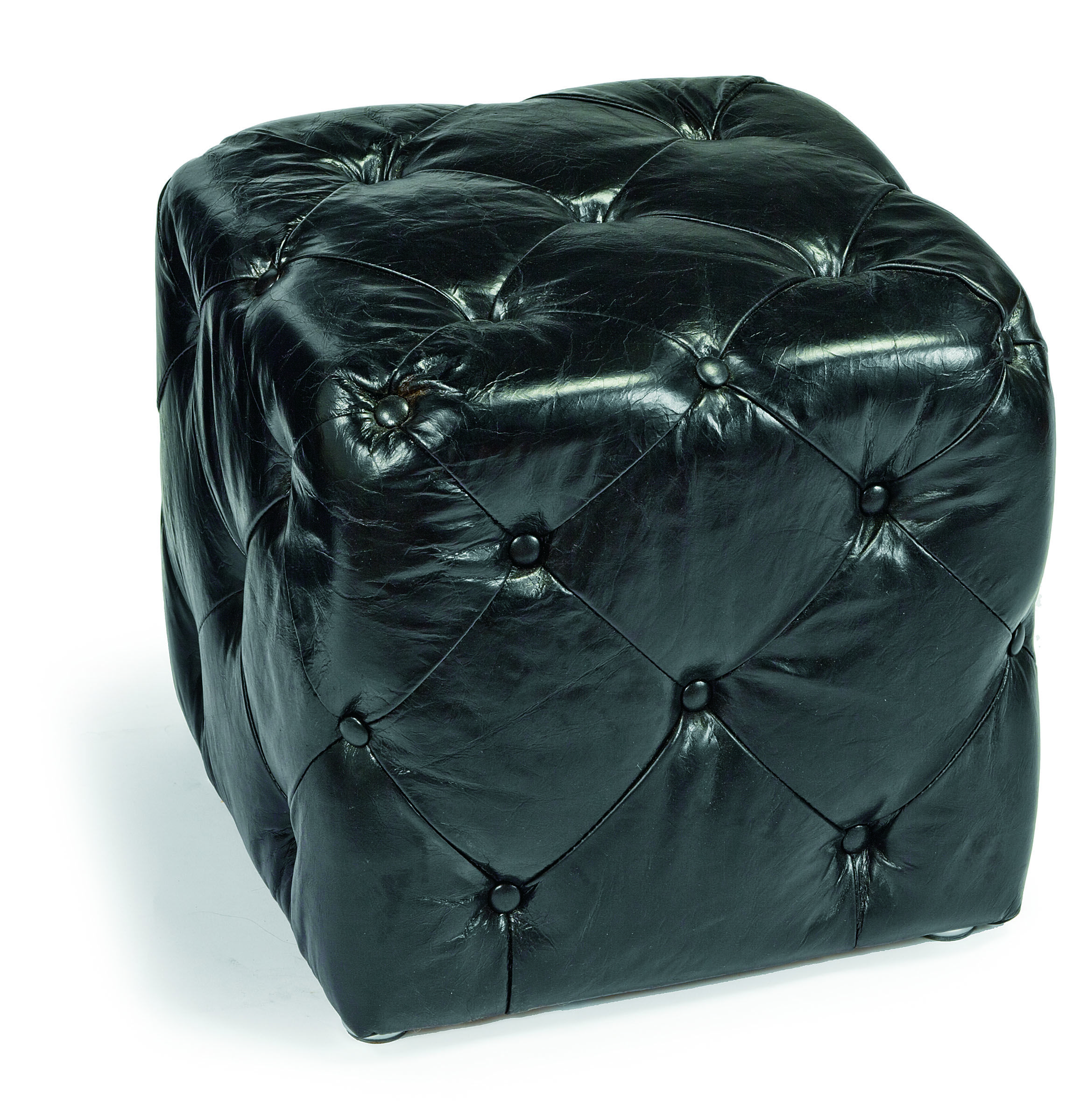 This ottoman looks punk rock with its high shine and tufting!  By Regina Andrew. TheHome.com #hpmkt