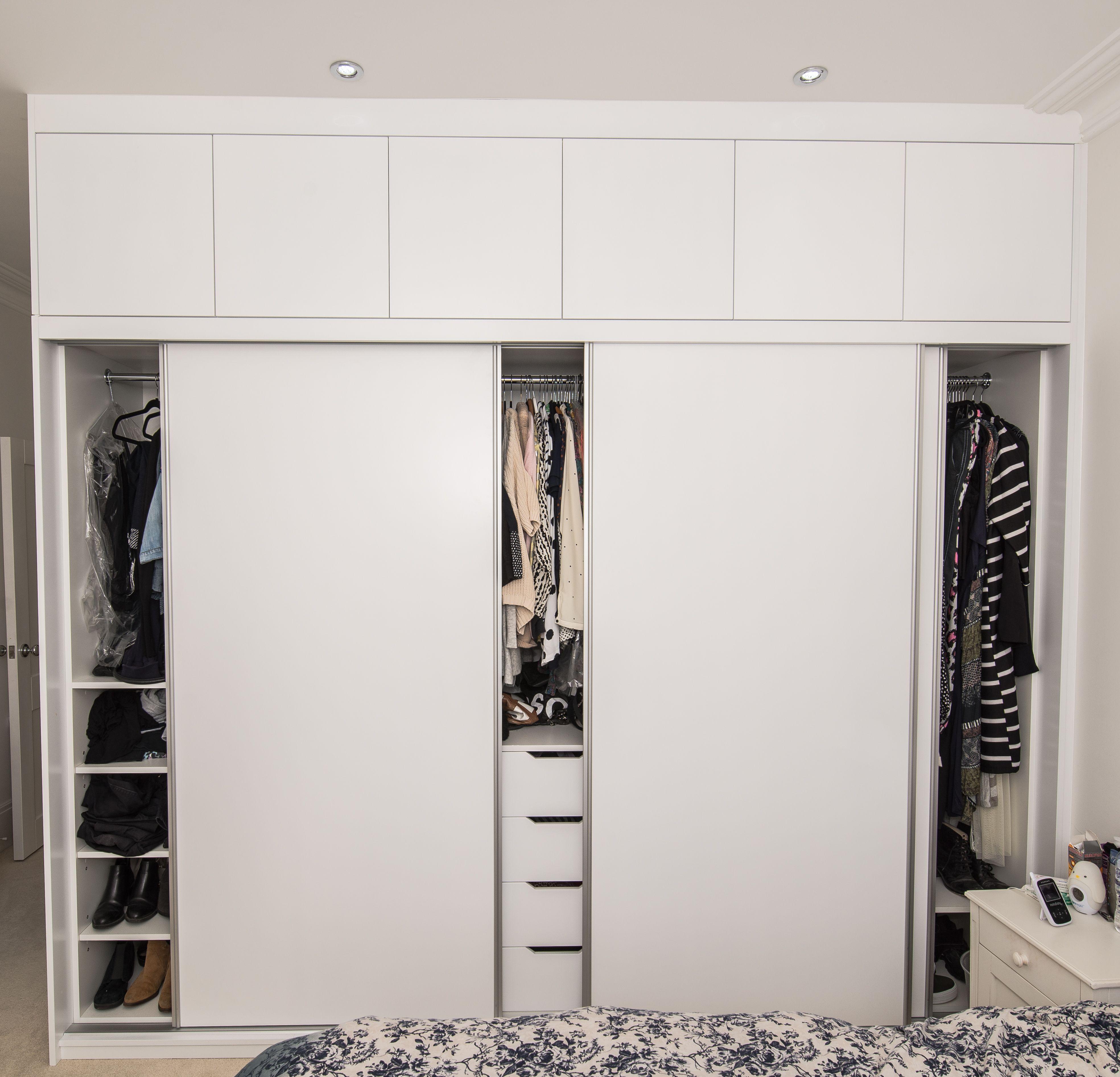 Custom Sprayed Bespoke Built In Sliding Door Wardrobe In White Eggshell Finish Inside You Can Find Hanging Wardrobe Storage Bedroom Wardrobe Built In Wardrobe