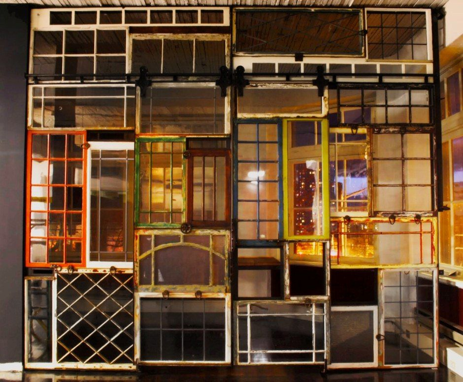 Partition wall made from reclaimed windows with two ...