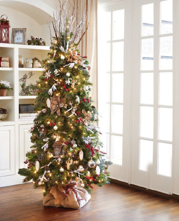 Burlap wrapped around the base of the tree with a ribbon gives a