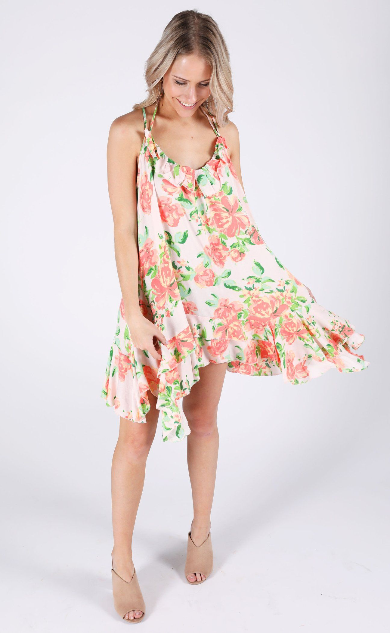 28555bf8b6a The perfect flirty floral dress for any spring event! It features a cool  strappy back