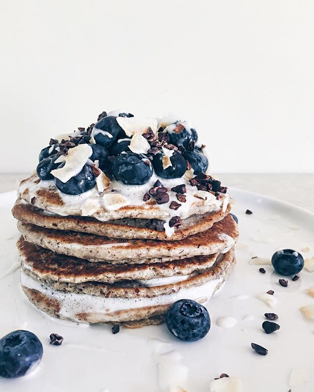 Slept in til 10:30, made these Coconut-Cardamom Pancakes with Blueberries, Coconut Cream and Cacao Nibs while bumping Drake with the house to myself. Sunday done right. #WuHaus