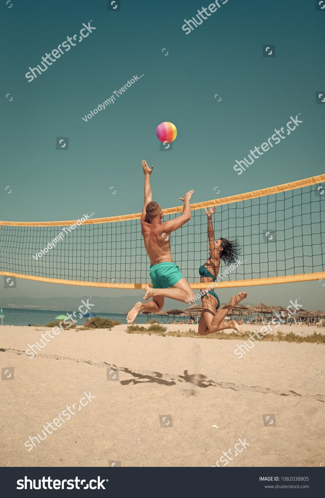 Couple Have Fun Playing Volleyball Young Sporty Active Couple Beat Off Volley Ball Play Game On Summer Day Woman And Play Activities Beach Volleyball Volley