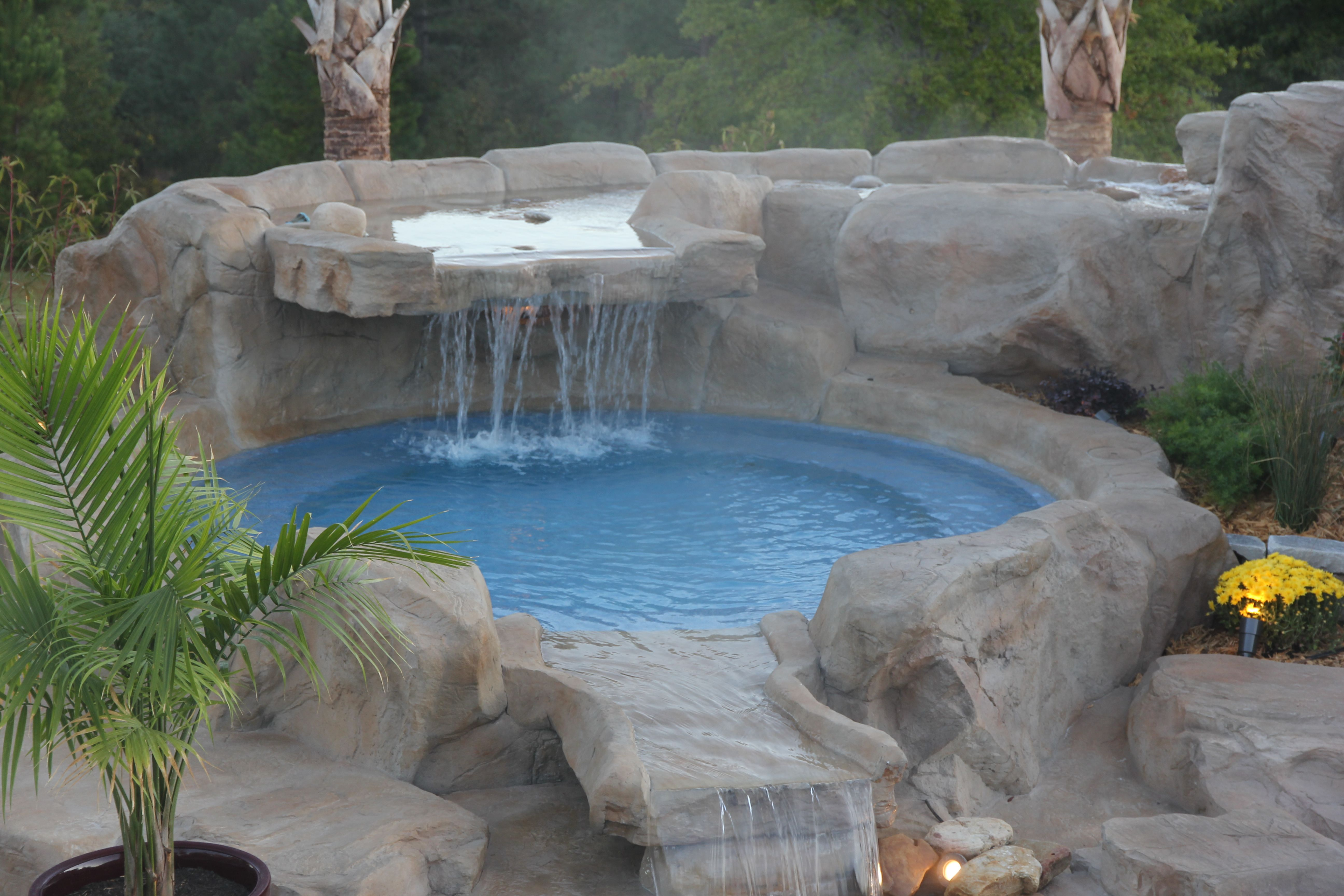 Fiberglass kiddie pool tanning pool by dolphin pools of for Rock waterfall