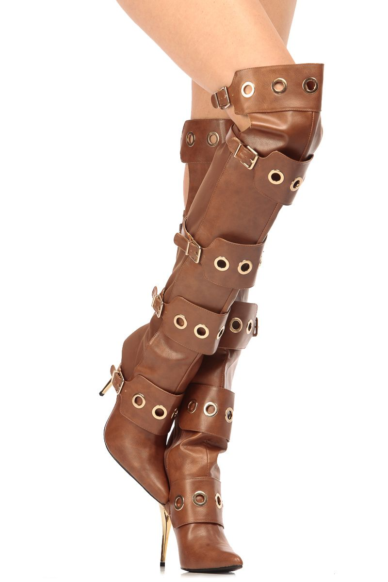The perfect pair to make a fashion statement all Winter long! This pair features a faux leather material, pointed toe cut, gold hardware, ring detailing through out front construction, adjustable buckles, thigh high design and a side zipper for closure. Pair these boots with your favorite mini dress and Gold accessories for an outstanding night time look.-True to size