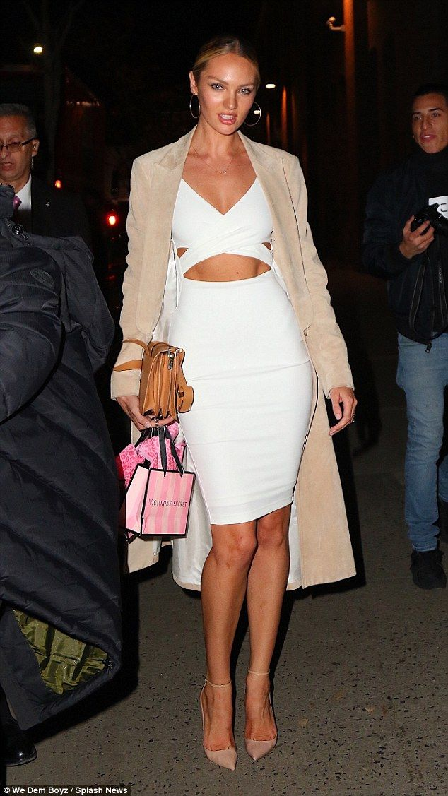 Top form: Candice Swanepoel proved that her lingerie model body is always in tact when she showed off her abs at the Victoria's Secret show viewing party on Tuesday night in New York