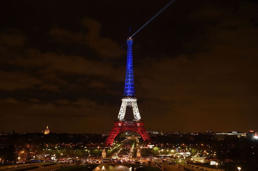 "17 NOV:  The Eiffel Tower has been reopened. At the request of Paris Mayor Anne Hidalgo the structure was lit in the colours of the French national flag in tribute to the victims of 13 November terror attacks which killed at least 129 people. The illumination together with a projection of the citys motto ""Fluctuat nec Mergitur"" onto the deck of the 1st floor will continue for three days.  PHOTO: ERIC FEFERBERG / AFP #BBCSnapshot #Photojournalism #EiffelTower #TourEiffel #Tricolore #Paris…"