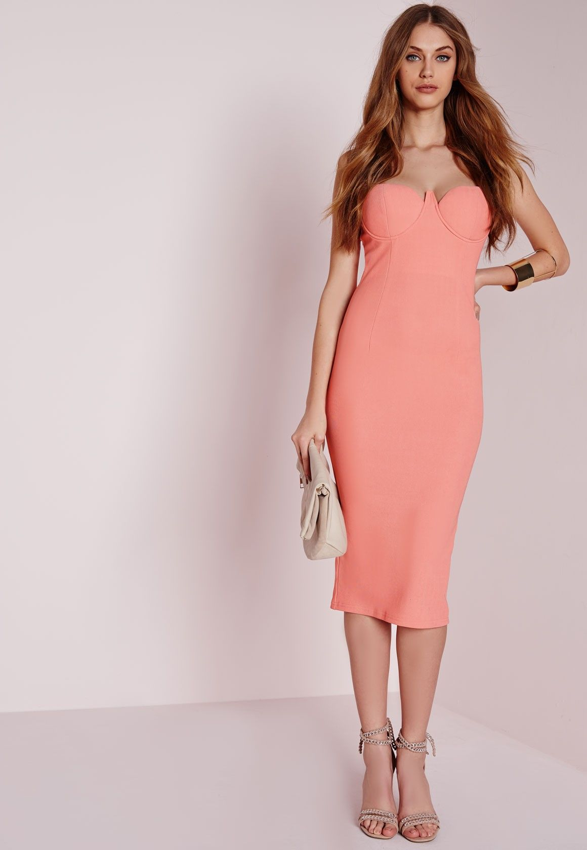 Hot damn girl, you're goina turn some heads in this one. This pink midi dress in figure flattering fabric is both sexy and classy. With strappy  details and bustier features, this dress will have you best dressed for sure. Style with some b...
