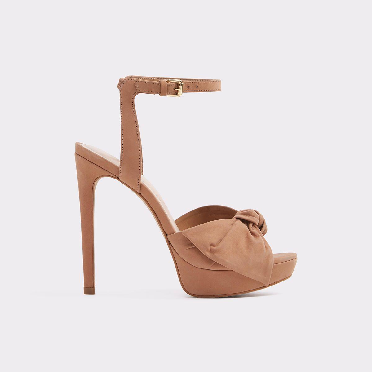 6292cc3790538 Sublimity A knotted bow enhances the feminine essence of an ankle-strap  sandal