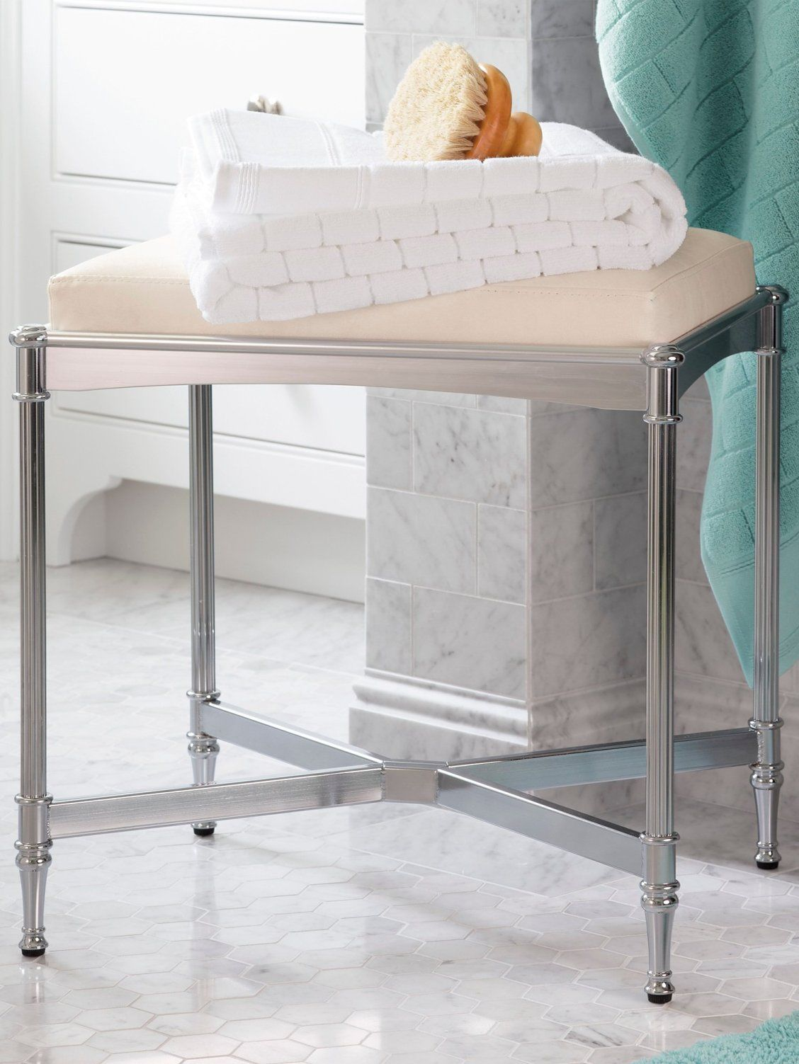 Our Belmont Vanity Stool brings polished sophistication to