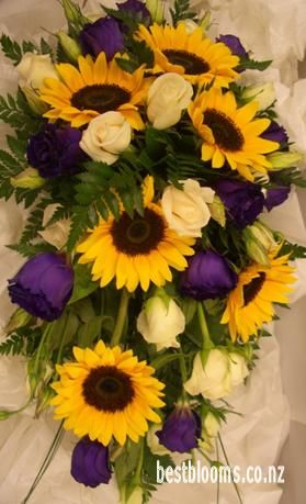 Trailing Wedding Bouquet Of Sunflowers And Lisianthus In Yellow Purple