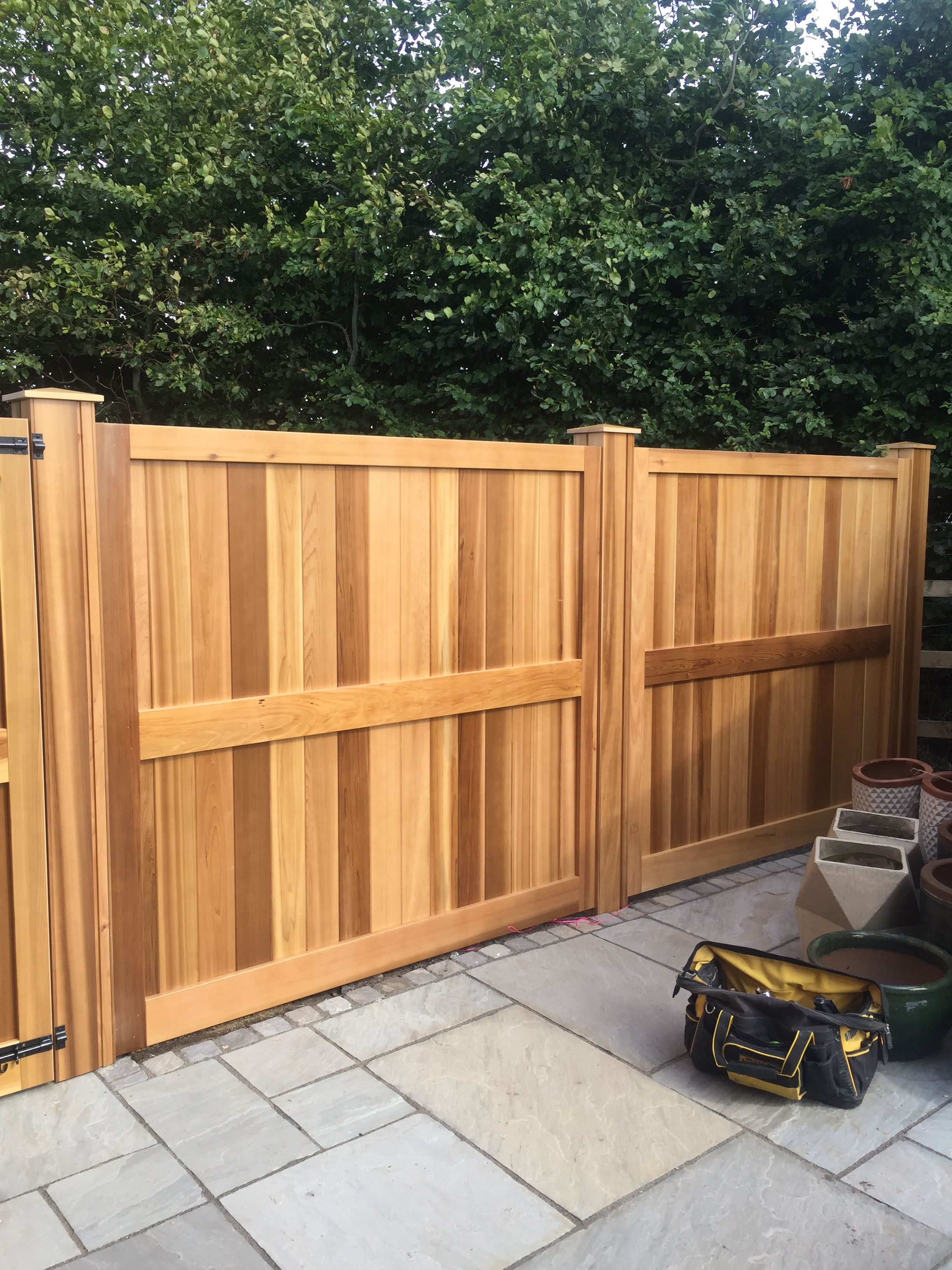 This fabulous bespoke cedar dividing fence with gate has ...