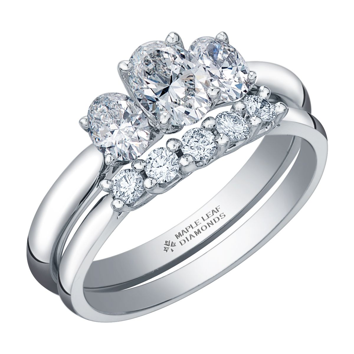 Three stone oval diamond engagement ring pictured with a