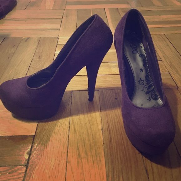 Purple high heels Never worn before size 6 1/2 stilettos. You could tell from the bottom they haven't stepped foot outside the house. Brand new Shoes Heels