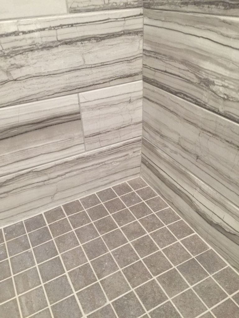 Vitaelegante grigio porcelain tile on the walls with mitte gray vitaelegante grigio porcelain tile on the walls with mitte gray glazed porcelain square tile floor and delorean grey grout in this custom shower dailygadgetfo Images
