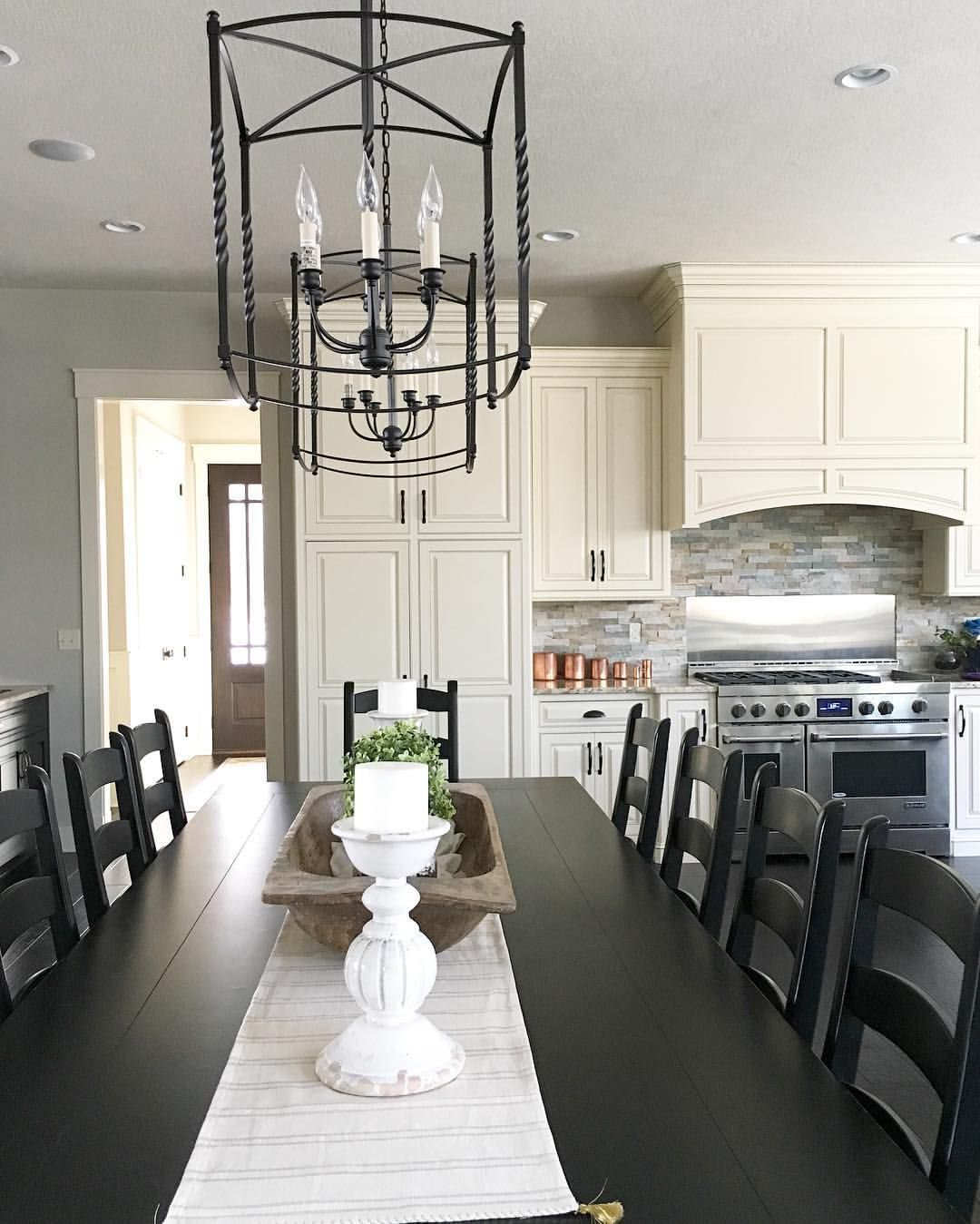 Modern Farmhouse Kitchen With Large Table And Lantern Chandeliers