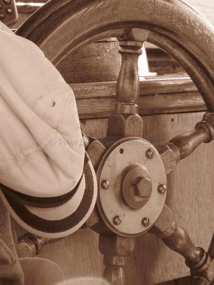 Captains wheel; boat; sepia photo by Polly Alexander Photography