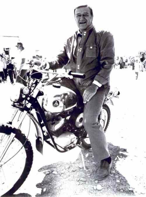 John Wayne loved to ride bikes. Hodaka Wombat on movie set